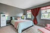 Master bedroom with pretty feature wall